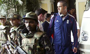 Kevin Pietersen prepares to board a bus as the England squad leave their hotel in Bhubaneswar