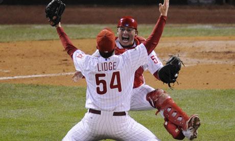 Philadelphia Phillies closer Brad Lidge celebrates with Carlos Ruiz after winning the World Series