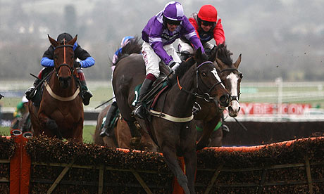 Awesome George, ridden by Charlie Huxley, clears the last on the way to victory at Cheltenham