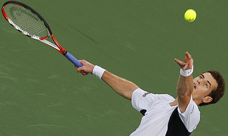 andy murray tennis. Andy Murray serves the ball to