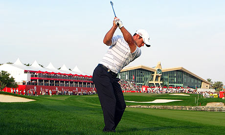 Paul Casey plays his second shot on the par five 18th hole during the Abu Dhabi Championship