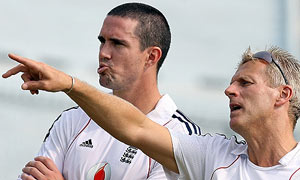 England cricket coach Peter Moores gestures as he talks with captain Kevin Pietersen