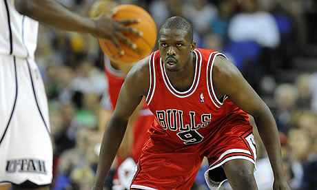 Luol Deng keeps his eye on the ball during the Chicago Bulls' game against the Utah Jazz in London