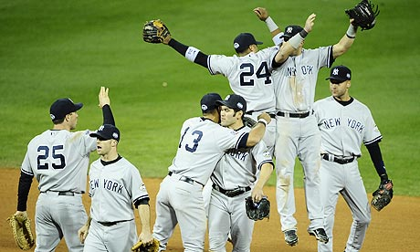 New York Yankees players celebrate winning game four of the World Series