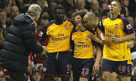 Arsenal's Andrey Arshavin, centre right, celebrates with team-mates