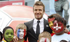 David Beckham poses with school children