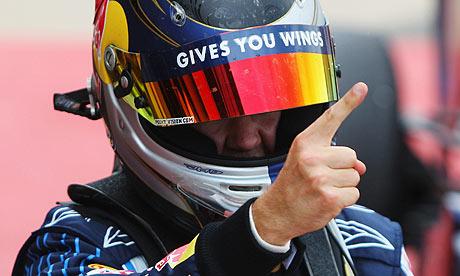 Red Bull's Sebastian Vettel celebrates after winning the British grand prix at Silverstone