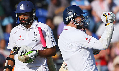 James Anderson celebrates securing the draw with Monty Panesar
