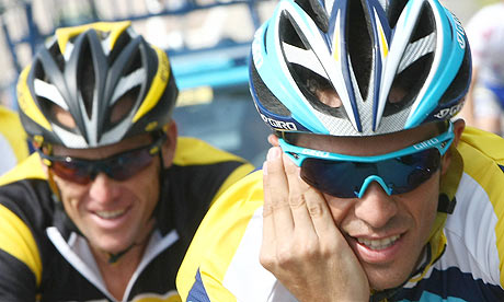 Alberto Contador rides ahead of Lance Armstrong during a training session in Limoges