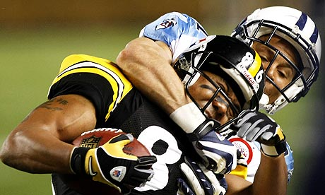 Hines Ward Super Bowl. Hines Ward is tackled by