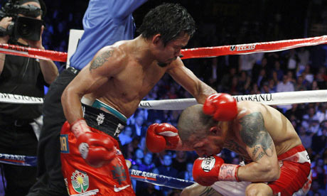 Manny Pacquiao of the Philippines punches Miguel Cotto of Puerto Rico