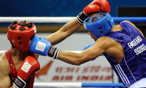 Anthony Ogogo (blue) against Vijender Singh in Delhi. Picture: Anthony Devlin/PA Wire.