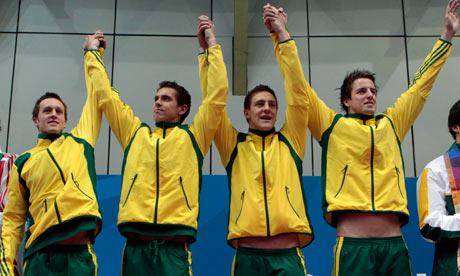 Australia celebrates winning the men's 4x100 metres freestyle swimming at the Commonwealth Games