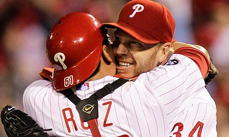 Roy Halladay celebrates with catcher Carlos Ruiz after his no-hitter