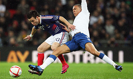 France's Mathieu Valbuena and Kieran Gibbs of England