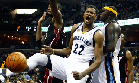 Memphis Grizzlies' Rudy Gay celebrates a dunk over the Miami Heat defense ...