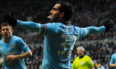 Carlos Tevez celebrates scoring City's second.