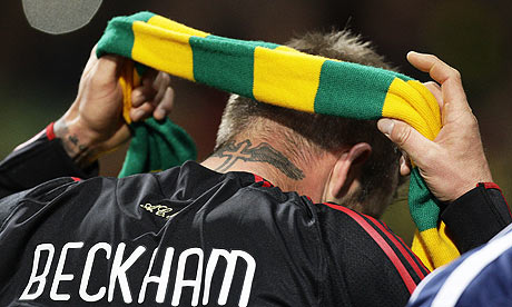 Beckham puts on a Green and Gold scarf