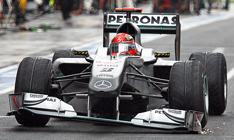 Michael Schumacher drives into the pits with a damaged front wing during the Australian grand prix
