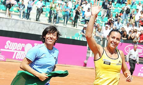 Italy's Flavia Pennetta (R) waves to her fans as she celebrates with teammate Francesca Schiavone