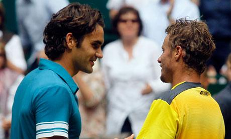 Roger Federer congratulates Lleyton Hewitt following the  Australian's 3-6, 7-6 (7-4), 6-4 victory