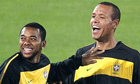Brazil's strikers Robinho (L) and Luis F