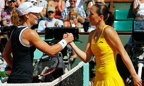 Serbia's Jelena Jankovic (R) shakes hand