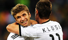 Germany's Thomas Muller celebrates scoring his sides fourth goal with Miroslav Klose.