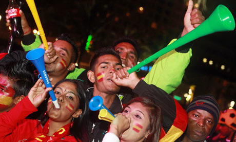 Spain supporters blow vuvuzelas at the D