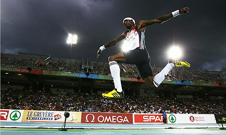 Phillips Idowu of Great Britain on his way to winning the gold medal in the men's triple jump