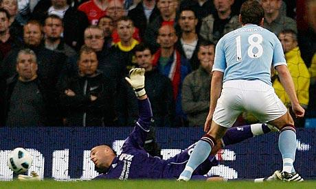 Gareth Barry scores past Pepe Reina