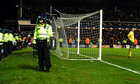 Police stand guard at St Andrew's last night.