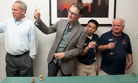 John W Henry toasts the employees in the Boston Red Sox ticket office