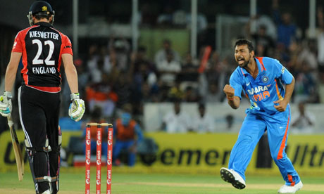 Praveen Kumar celebrates the wicket of Craig Kieswetter