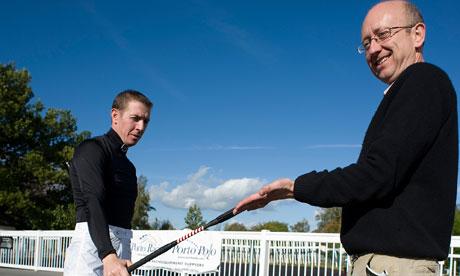 Jockey Jim Crowley whips Greg Wood at Lingfield.