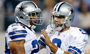 Dallas Cowboys quarterback Tony Romo talks to his fullback Tony Fiammetta