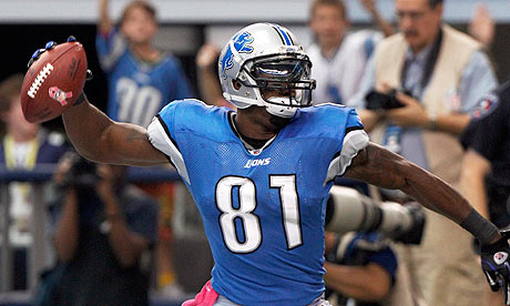The Detroit Lions wide receiver Calvin Johnson celebrates a touchdown against the Dallas Cowboys
