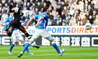 Newcastle United's Demba Ba heads the ball towards goal