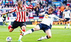Sunderland's goalscorer Nicklas Bendtner, left, in action against Bolton Wanderer's David Wheater.