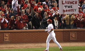 St. Louis Cardinals' Lance Berkman scores