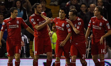 Downing, Carroll, Suárez, Adam and Henderson celebrating our second