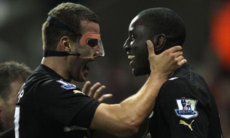 Steven Taylor, left, congratulates the Newcastle goalscorer Demba Ba