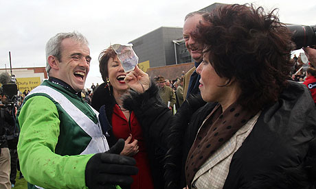 Ruby Wax shows Ruby Walsh her winnings at Newbury