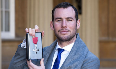 Cyclist Mark Cavendish collects MBE from Queen at Buckingham Palace