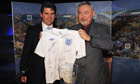 The mayor of Krakow, Jacek Majchrowski, accepts a signed England shirt from Adrian Bevington