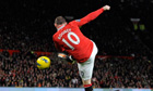Manchester United's Rooney shoots to score his second goal