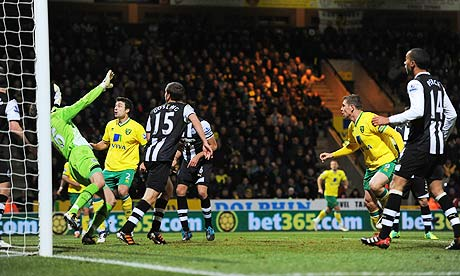 Norwich City's Grant Holt, right, scores their second goal against Newcastle United.