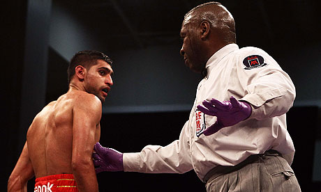 Referee Joe Cooper was criticised by Amir Khan