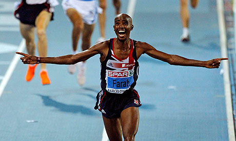 Britain's Mo Farah celebrates as he wins the men's 10,000m European Athletics Championship