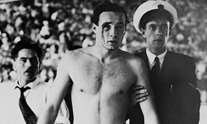 Hungary's Ervin Zador is escorted from the pool during their 1956 Olympic water polo win over Russia